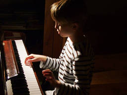 A kid learning the piano