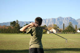 A kid playing golf