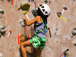 Kids engaging in indoor rock climbing should wear proper gear.