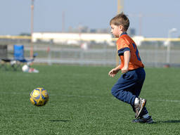 A kid getting fit at soccer camp.