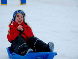 Sleighing is the most basic snow sport that kids can learn.