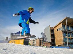 Snowboarding is a popular advanced snow sport among kids today.