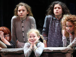Children performing Annie, a Broadway musical featuring kids