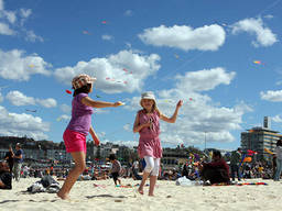 Kite flying is a popular school holiday activity in Bondi Beach.