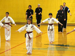 Kids learning self-defence at a martial arts school