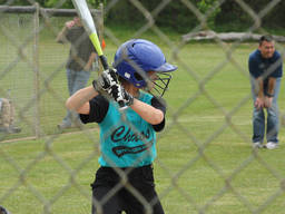 A child concentrates as he prepares to bat