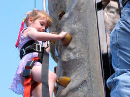 Little girls's first rock climbing experience