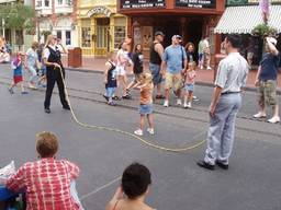 Young girl learning how to jump rope