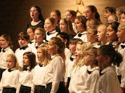 Girls and boys singing in harmony.