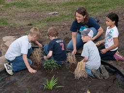 Children studying plants with an instructor
