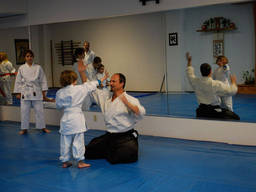 Kids learning and applying Aikido in class