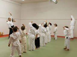 Kids warming up for their first aikido school day