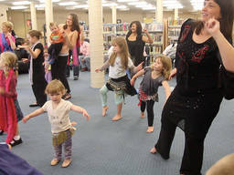 Moms and kids during a ballroom dance lesson
