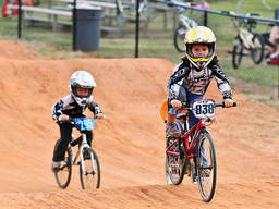 Young BMXers during a race
