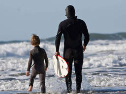 Father and son ready to hit the waves.