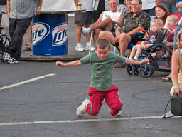 Little boy showing what he's got through simple breakdance moves.