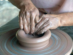 A person working on a pottery wheel