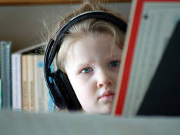 A little girl studying music