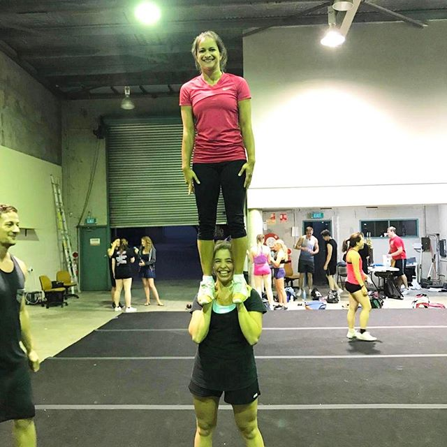 "Clever cheerleading coach Georgie turning the idea of ""handstands"" on its head!"
