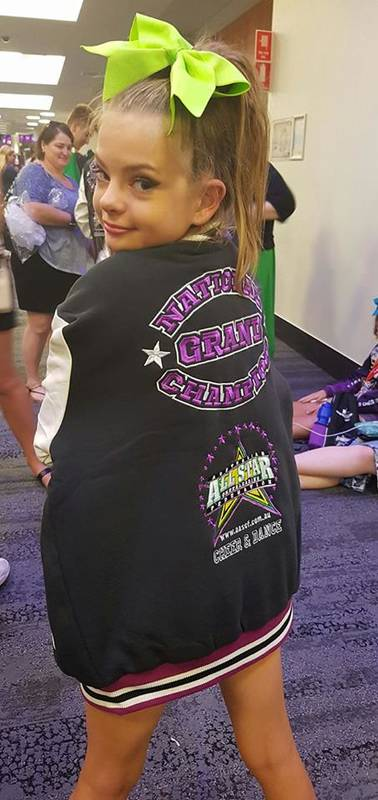 One of our Teen athletes showing off her Grand Champion jacket!